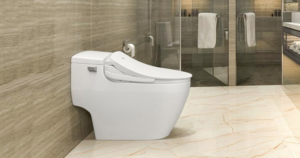 white toilet in bathroom with bidet toilet seat attached