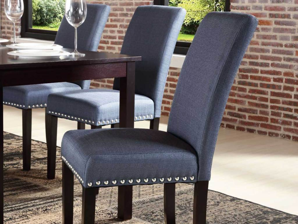 set of blue studded dining room chairs