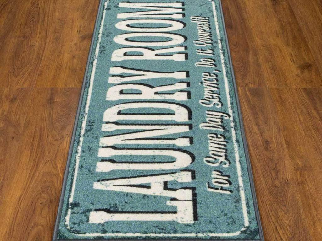 blue laundry room runner rug on wood floor