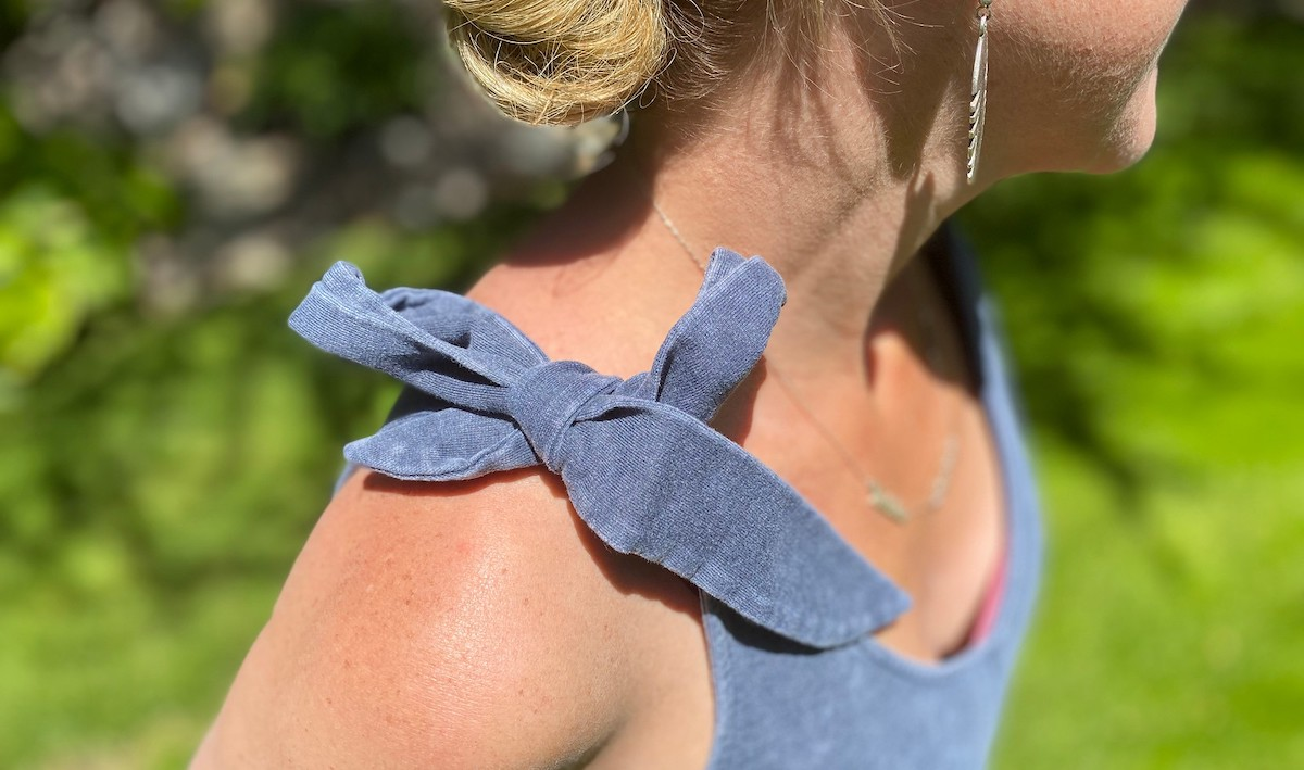 close up of bowtie on women's jumpsuit romper