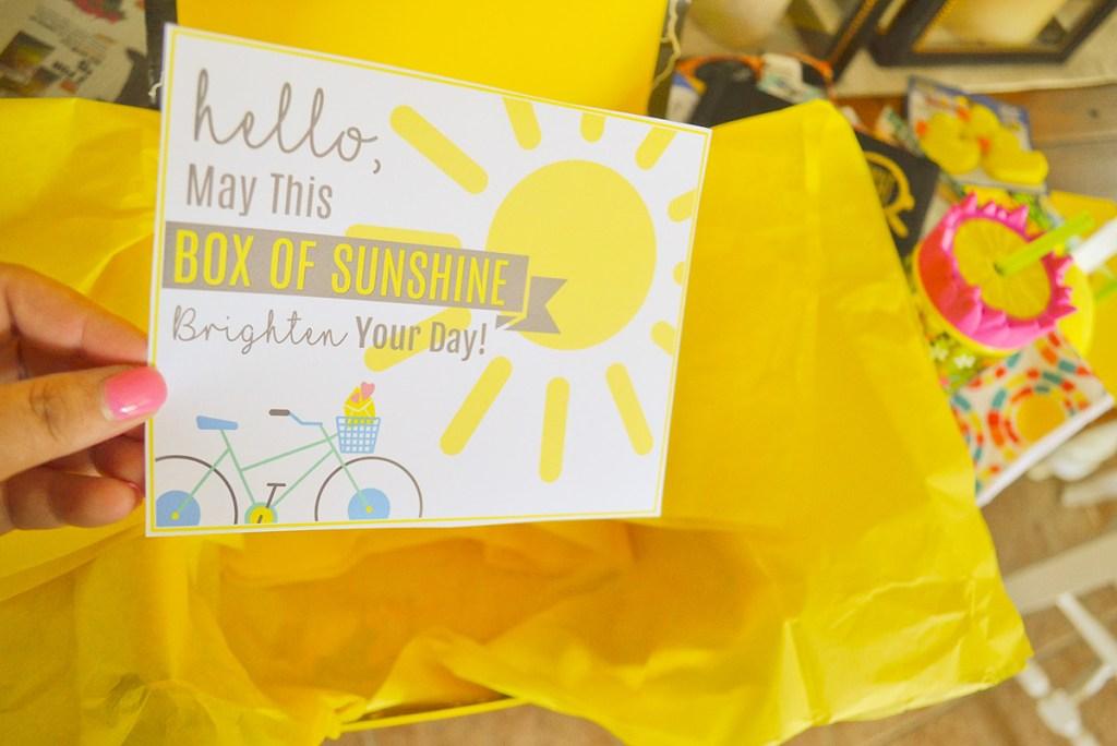hand holding box of sunshine card