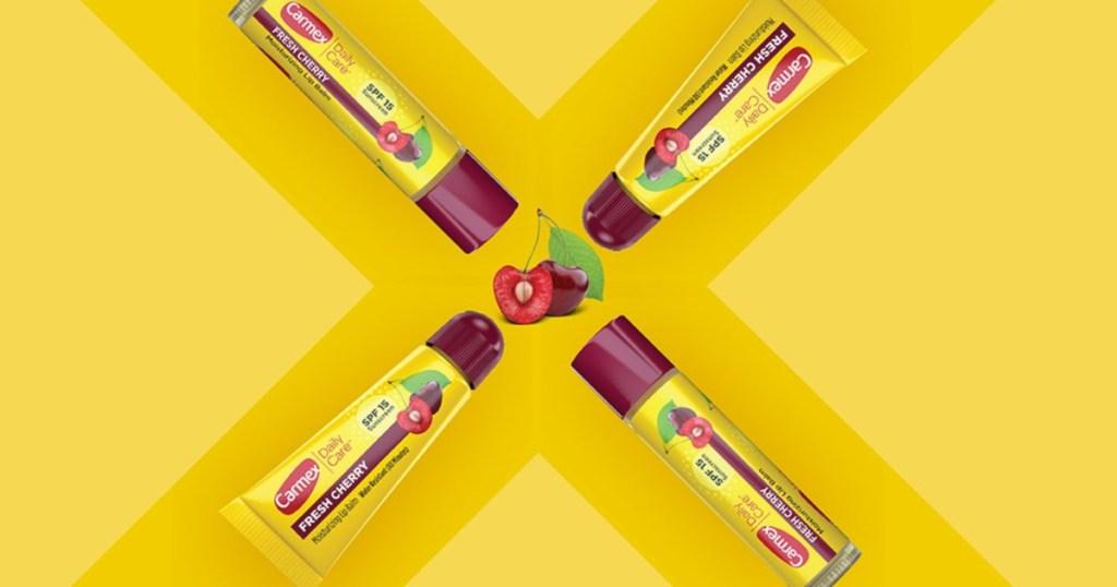 carmex cherry with 4 chapsticks on yellow background