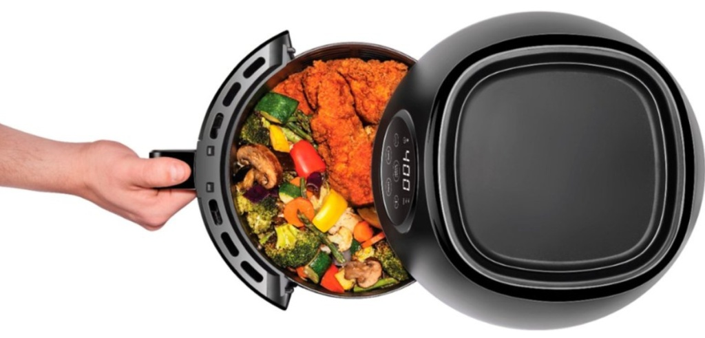 Best Air Fryer - hand pulling out basket of fried foods from air fryer