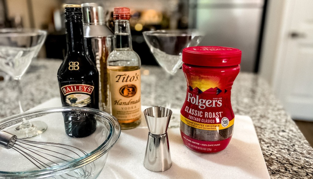 dalgona martini ingredients of baileys titos and folgers on kitchen counter with bowl