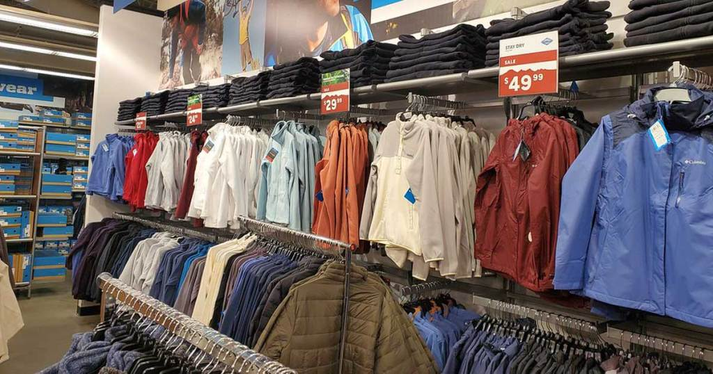 row of jackets hanging in store during spring sale