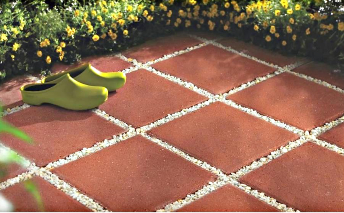 concrete blocks with shoes and flower bed around