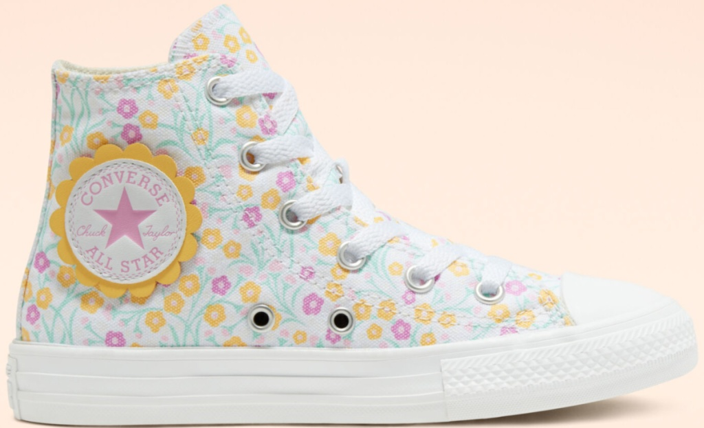 converse kids floral shoe one shoe pink background