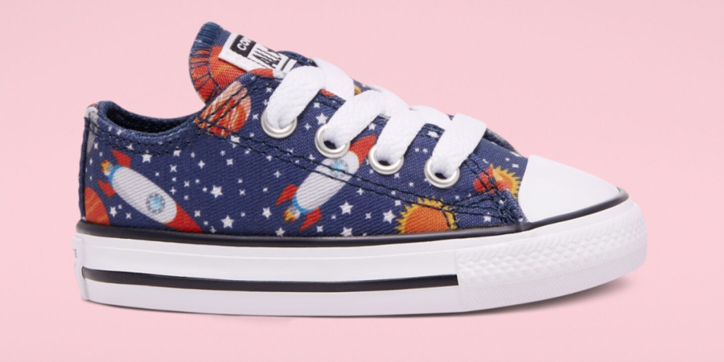converse toddler outer space shoe one shoe pink background