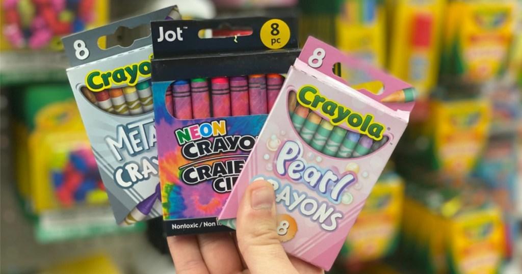 crayola crayons in hand at dollar tree