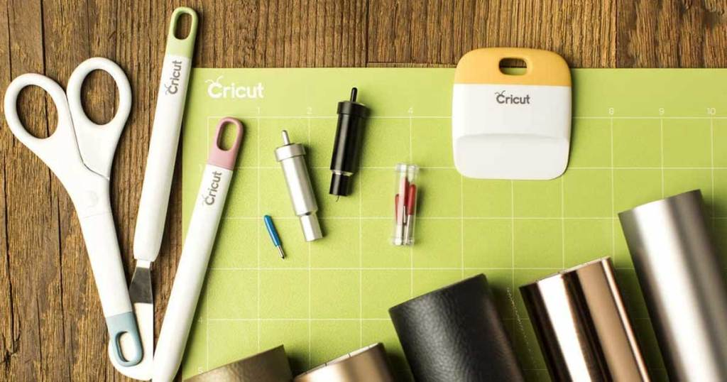 cricut machine accessories laid out on table