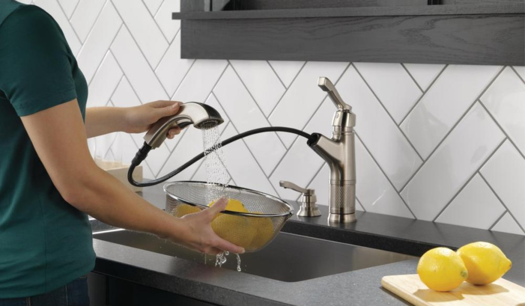 delta allentown faucet with woman washing