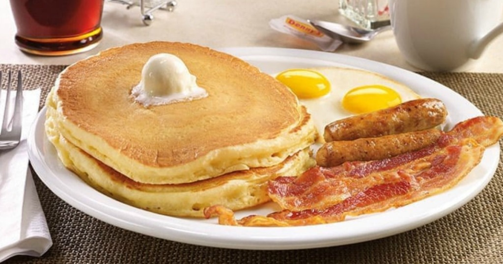 plate with pancakes bacon and eggs
