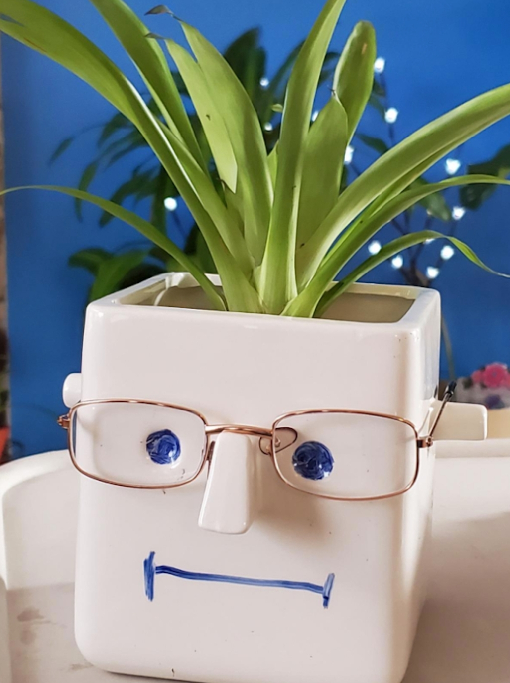 white planer box with face and glasses on it