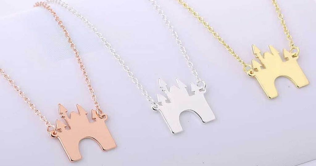 three Disney castle necklaces in rose, silver and yellow