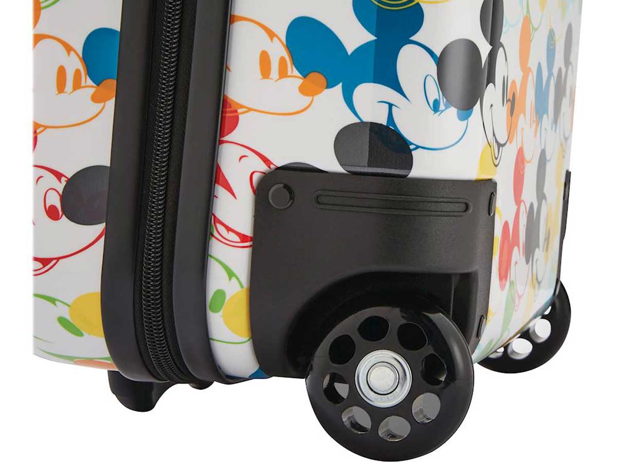 up close view of mickey mouse suitcase and wheel