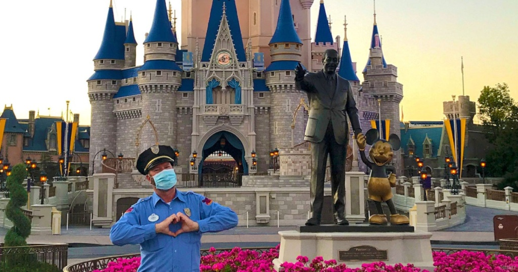 masked security guard in front of Cinderella's castle