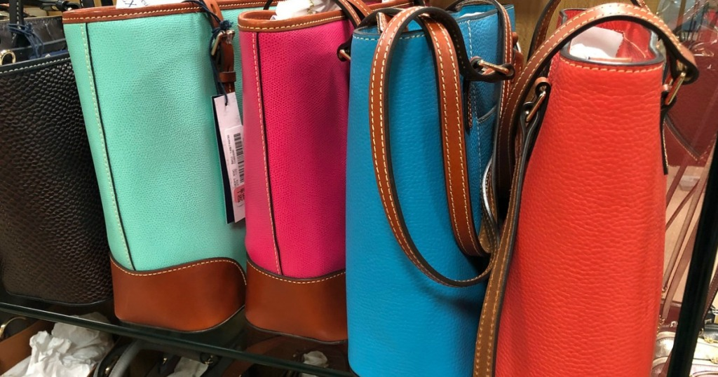 tote bags in different colors in store display