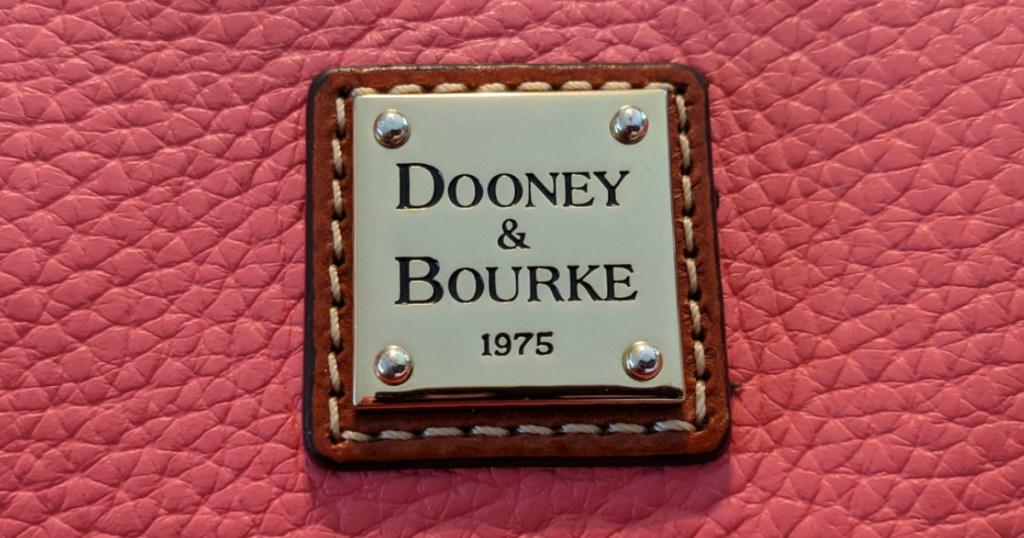 logo on a pink purse