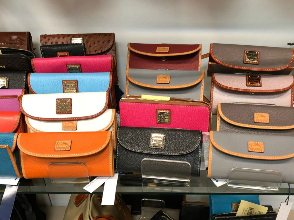 store display with several colors of women's wallets