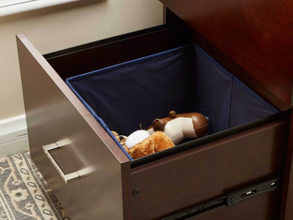 bin inside a drawer with toys