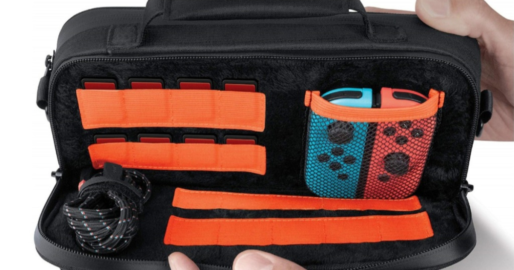 hands holding open handheld gaming console case with accessories inside