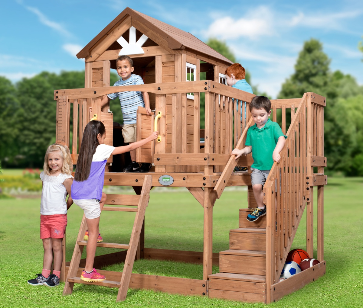 kids playing in elevated playhouse