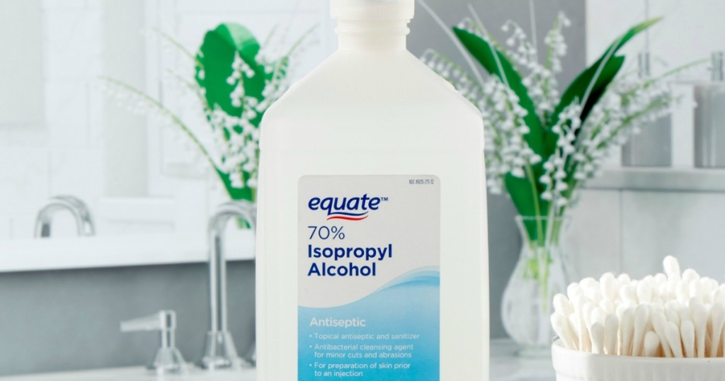 bottle of equate isopropyl alcohol next to container of q-tips