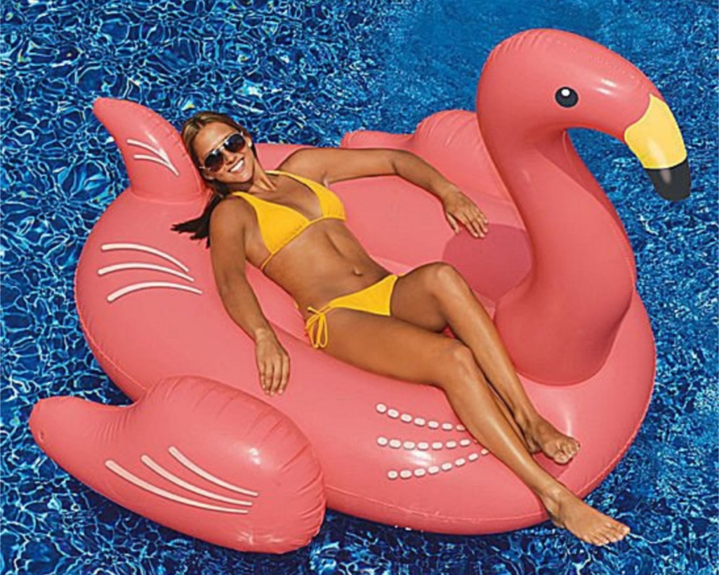 flamingo pool float with woman on it