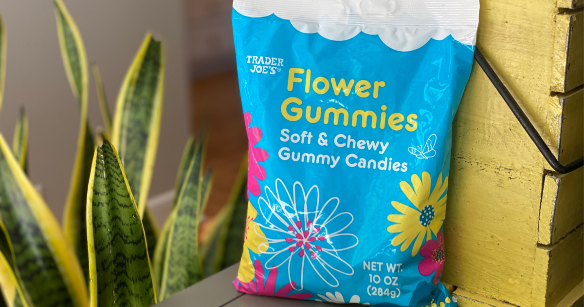 flower gummies in bag next to planter and plant