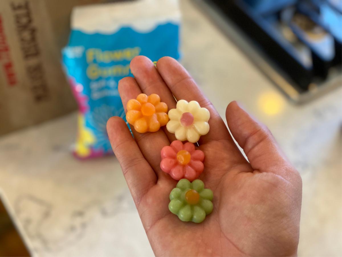 flower gummies in hand