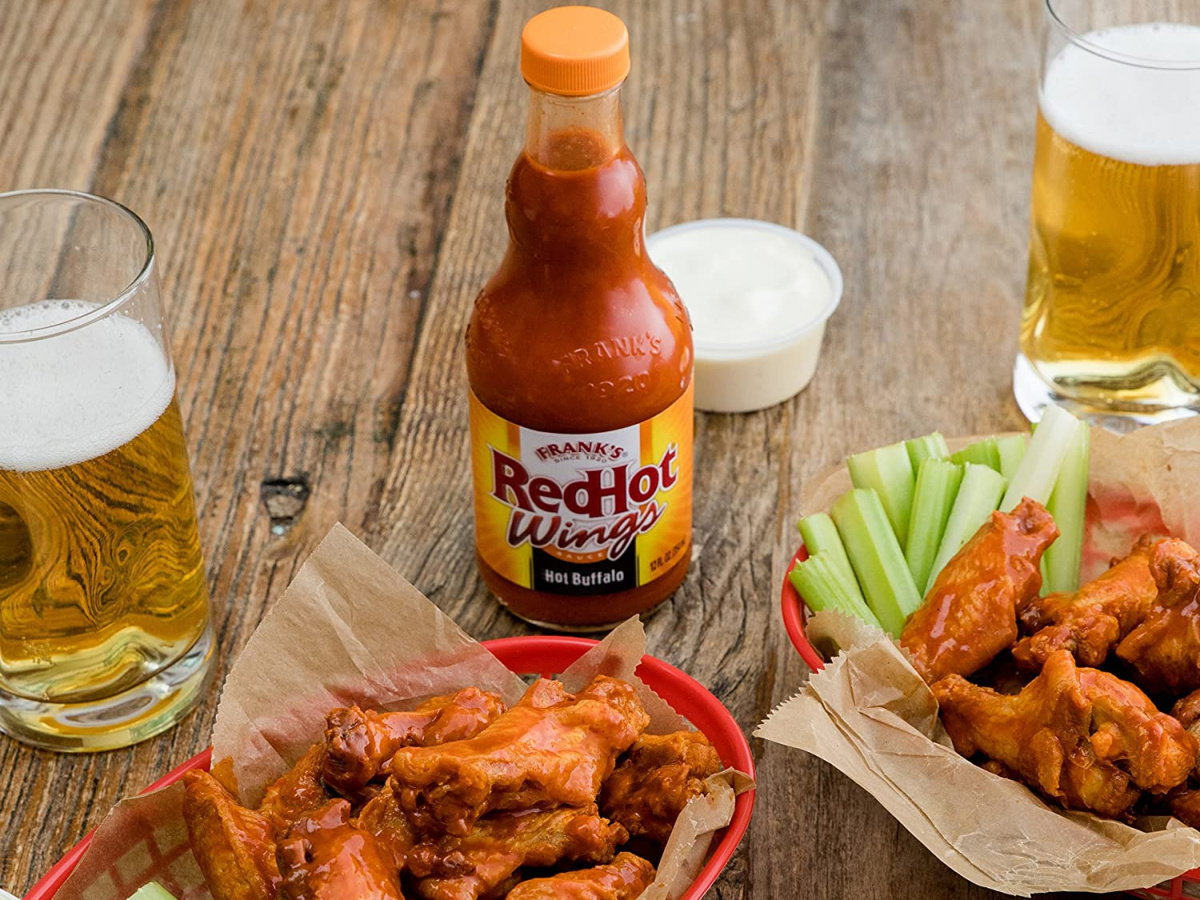 franks red hot wing sauce on table with wings and beers