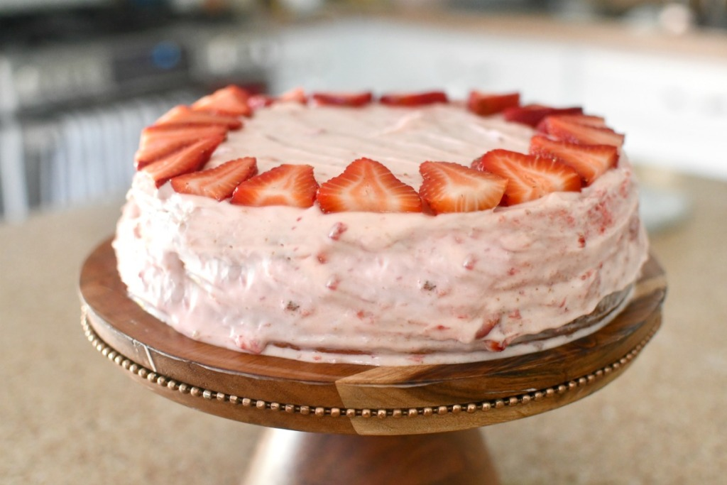frosted cake with fresh strawberries