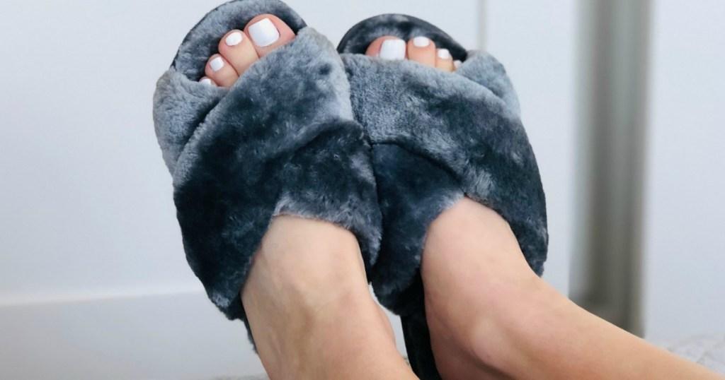 wearing fuzzy grey slippers