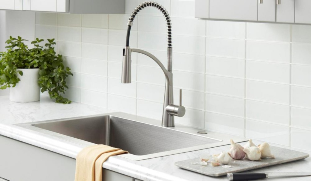 glacier bay commercial style faucet in all white kitchen