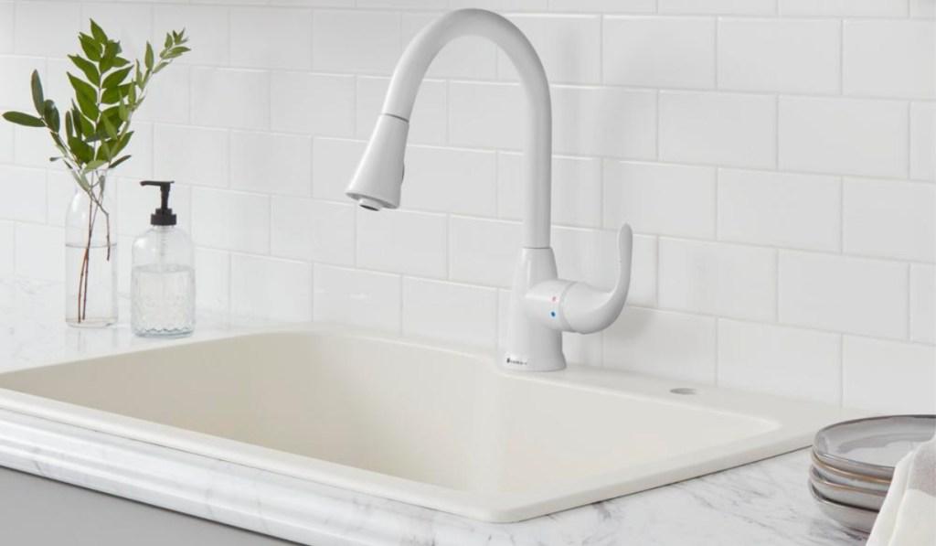 glacier bay faucet in all white kitchen
