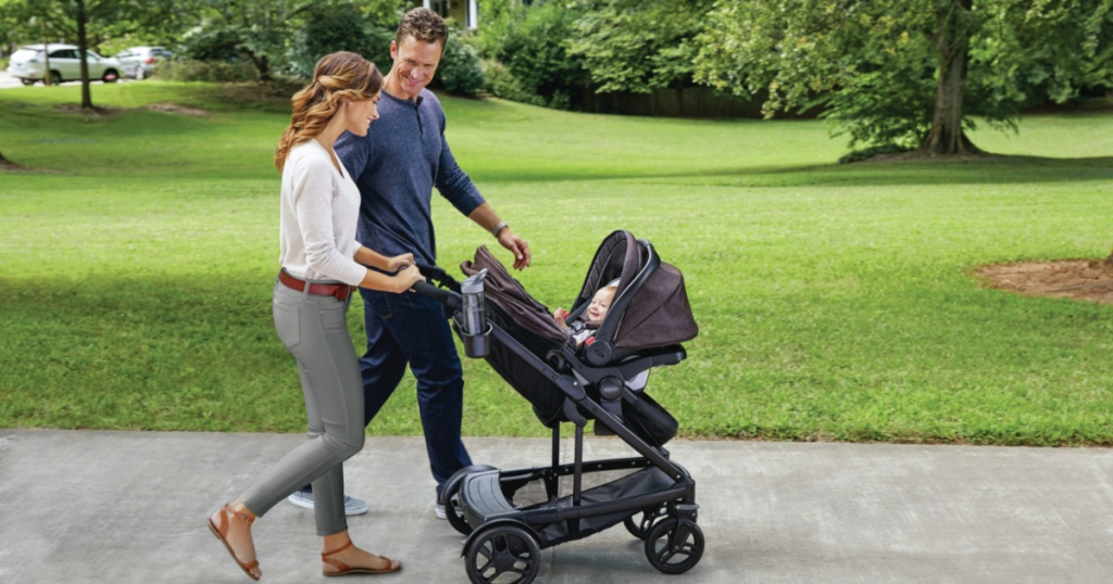man and woman walking stroller