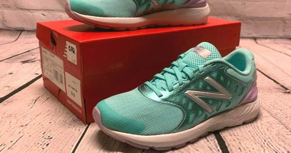 new balance running shoes propped on a shoe box