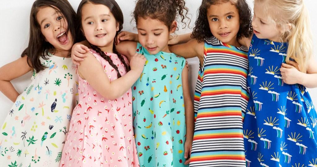 girls wearing cute dresses smiling