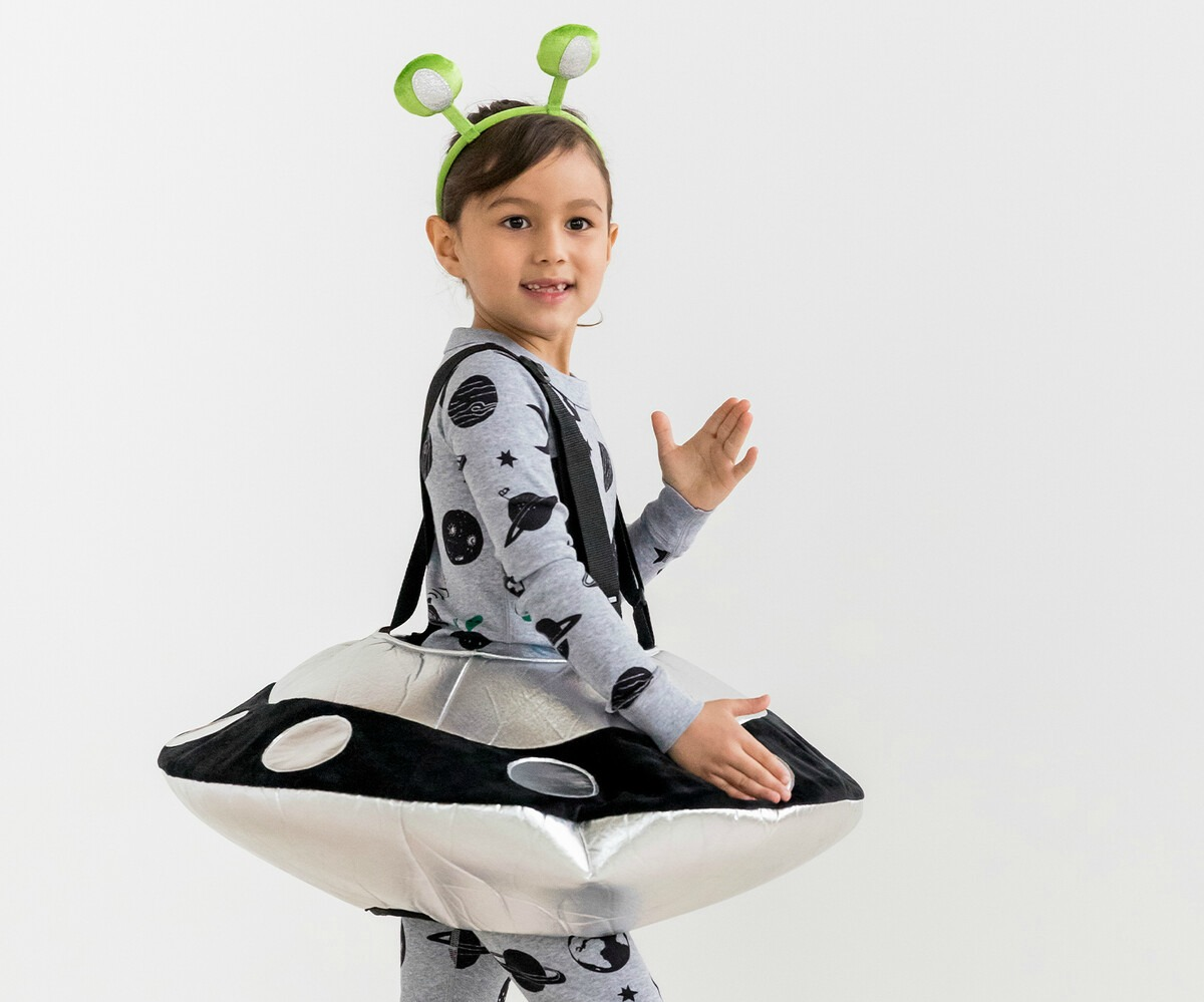 girl wearing a space ship costume and alien headband