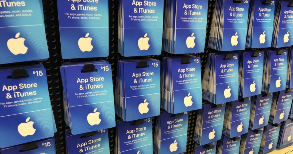 several itunes gift card on shelfs against wall