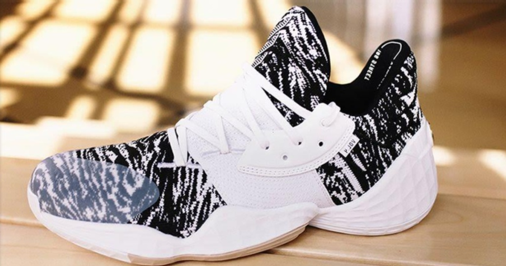 white and black lace up shoes