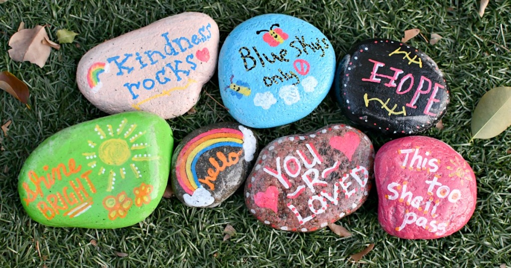 painted kindness rocks on the grass