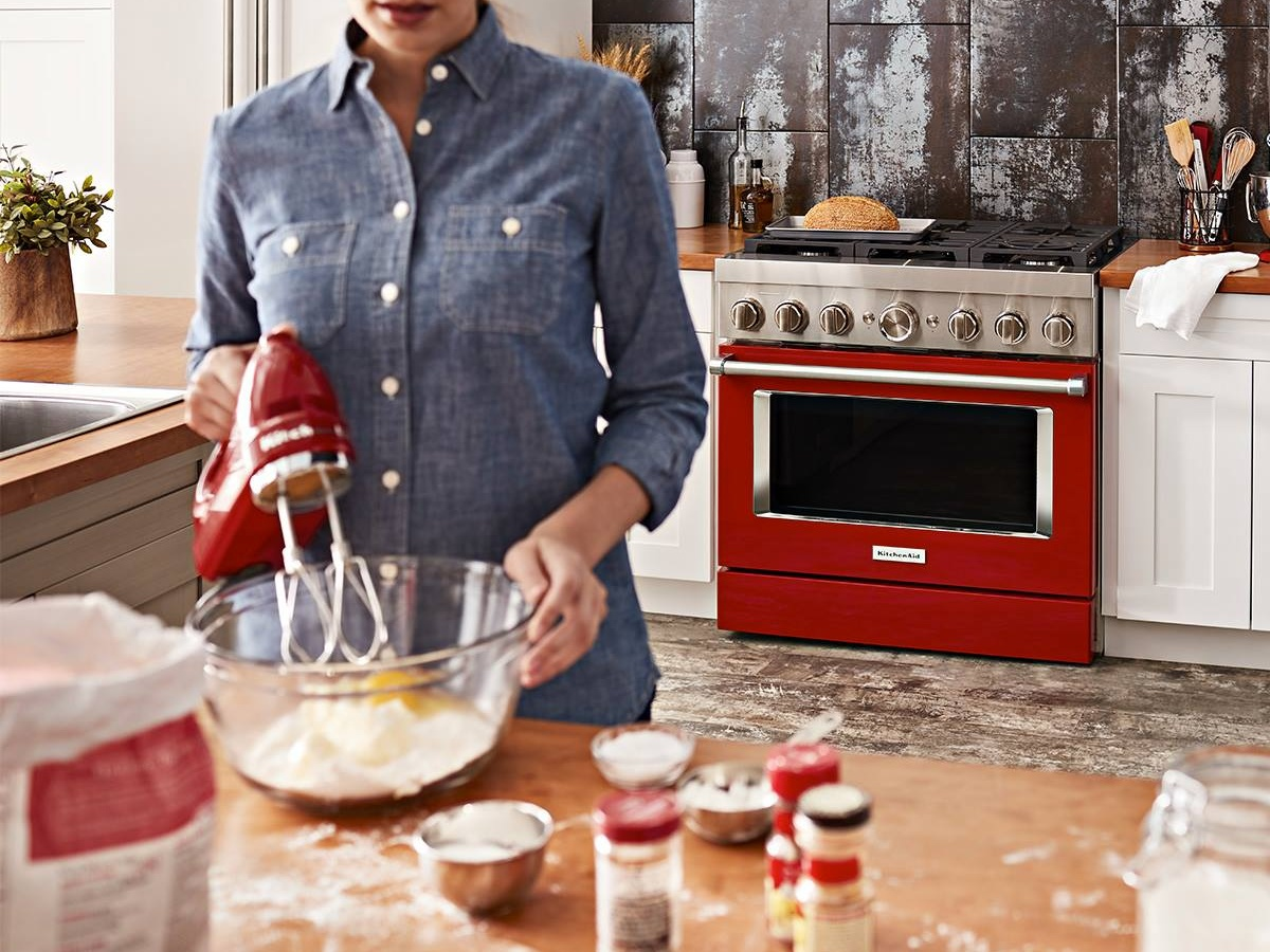 woman baking with red appliances