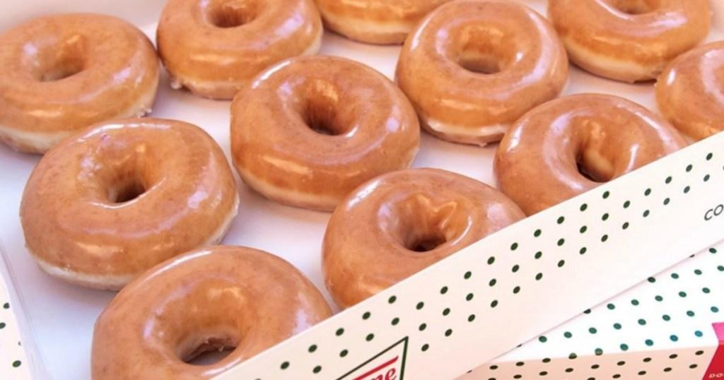 two boxes of Krispy Kreme doughnuts