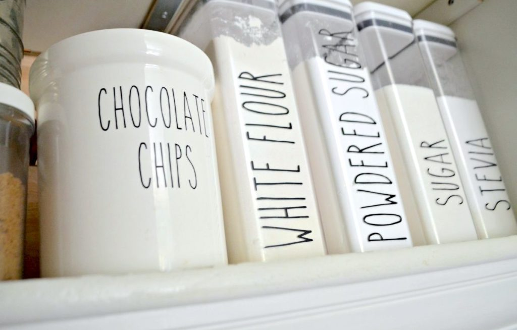 row of baking goods in plastic containers with modern labels