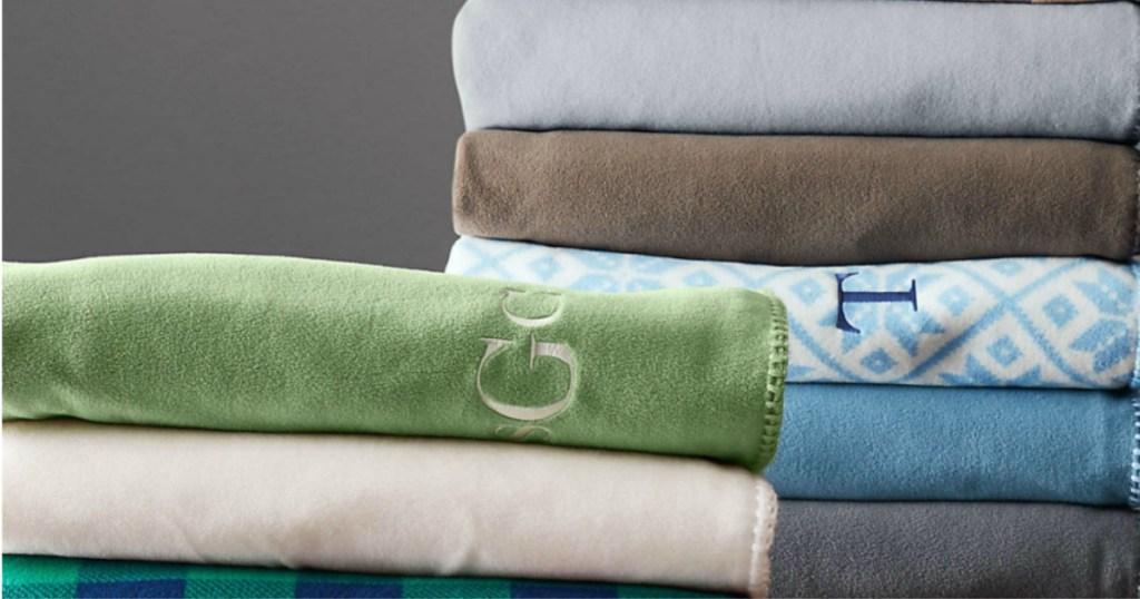 plush fleece monogram throws