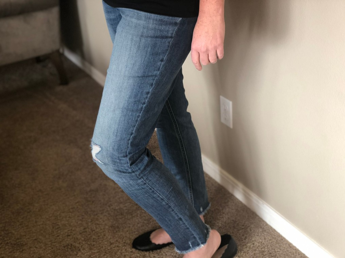 woman wearing jeans and black flats
