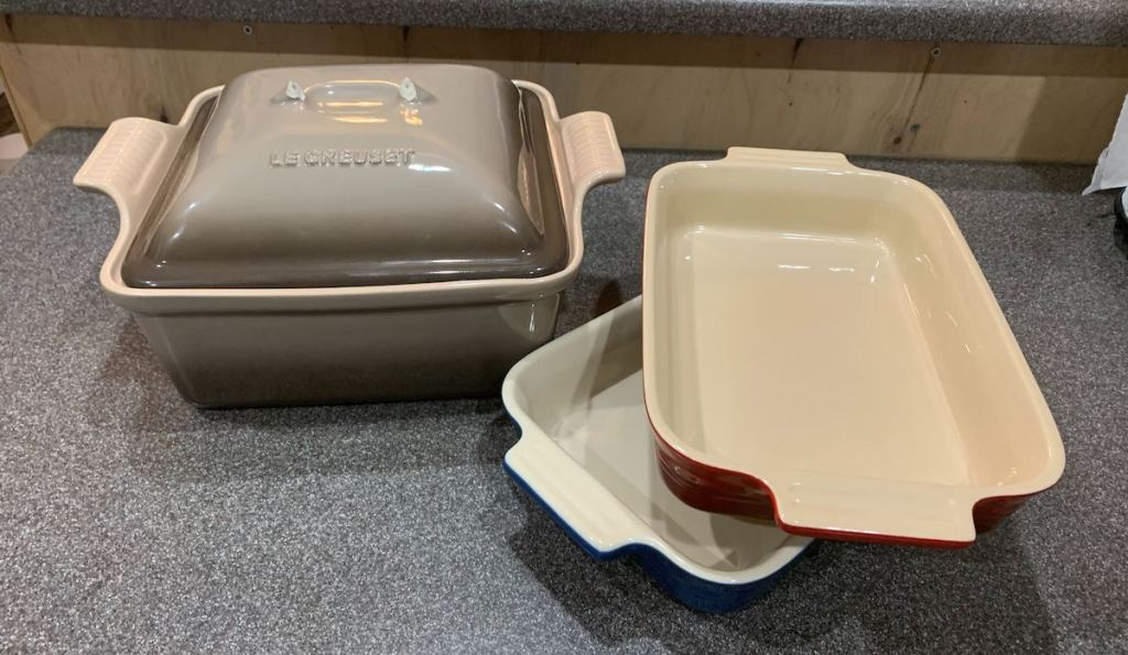 Three baking dishes sitting on counter to