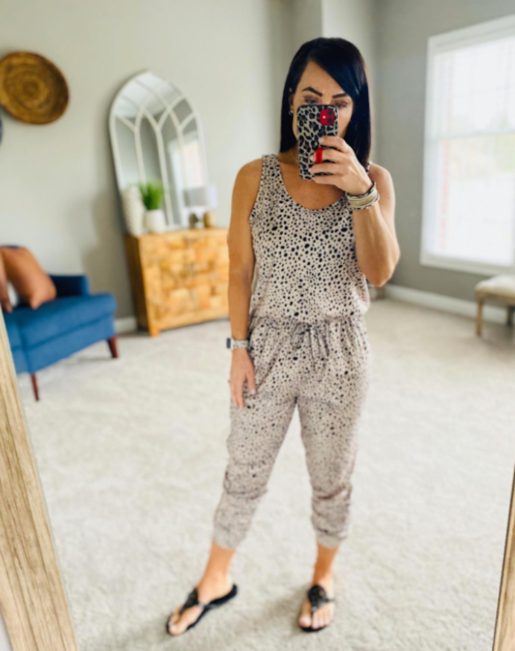 woman taking selfie in mirror wearing leopard jumpsuit womens jumpsuits and rompers