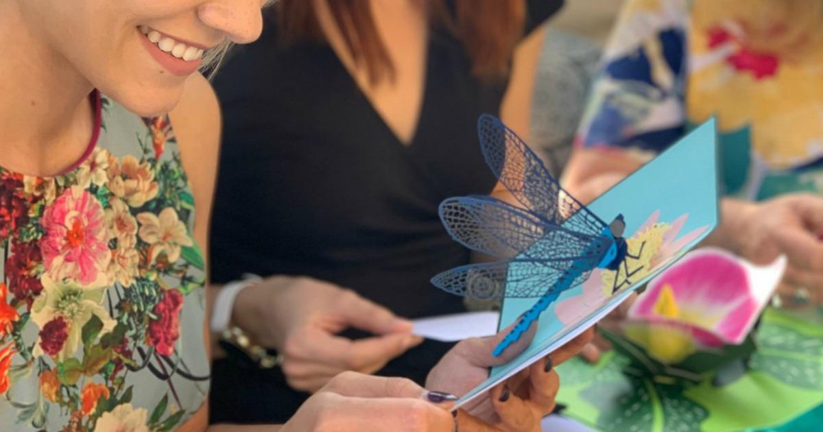 woman opening 3d butterfly lovepop card